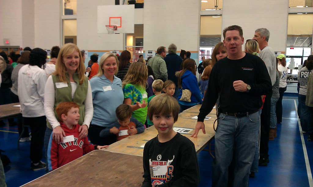 J.D. Miles & Sons, Inc. volunteers at the Virginia Wesleyan College family day event